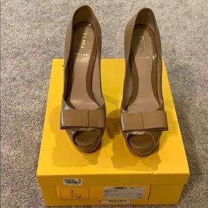 Authentic Fendi peep toe heels in tan color